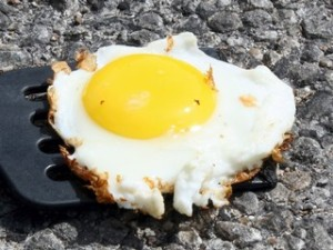 flippin hot.  eggs over sidewalk?
